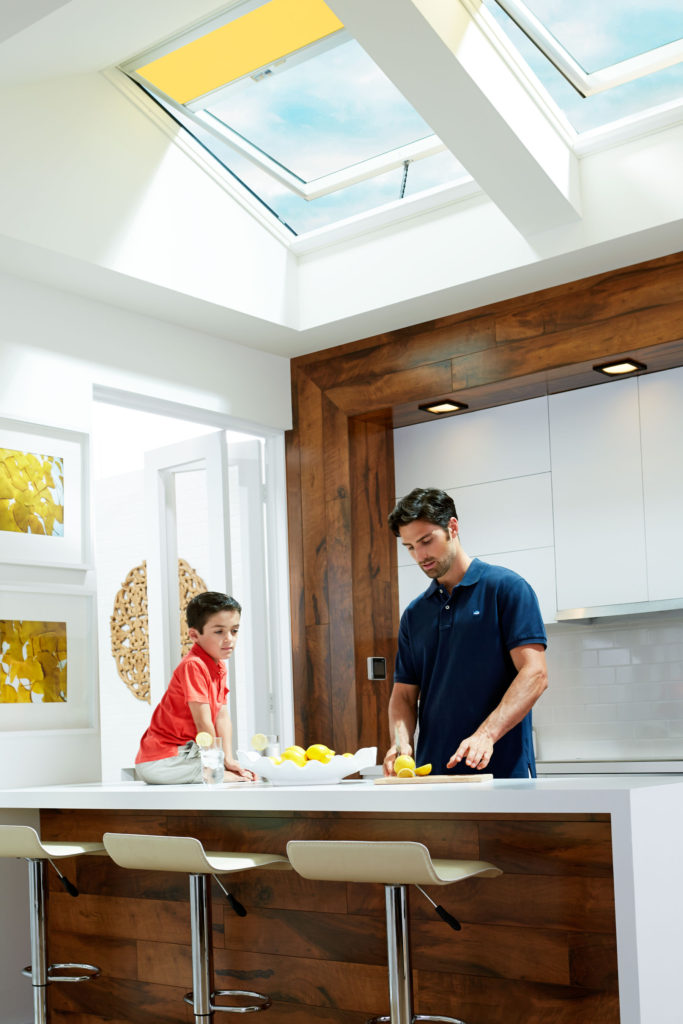 yellow blinds skylights over kitchen