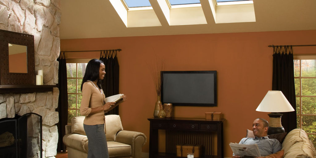 Skylights and couple in living room.