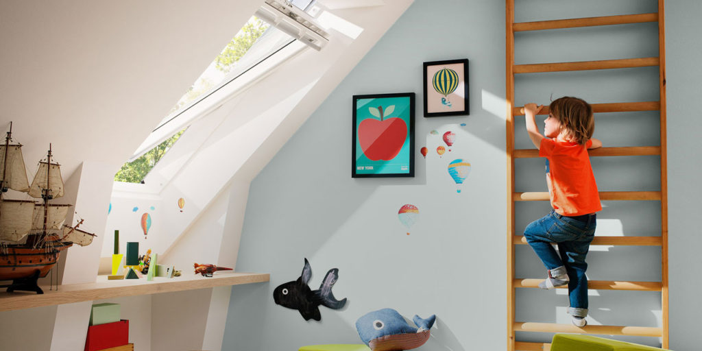 Velux roof window and boy climbing ladder.