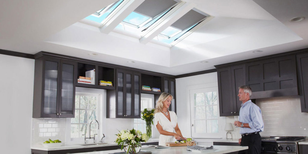 Venting skylights in brown kitchen.