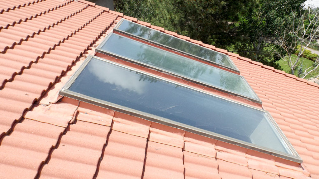 Old skylights on tile roof
