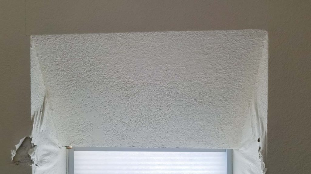 Drywall damage due to a skylight seal leak.