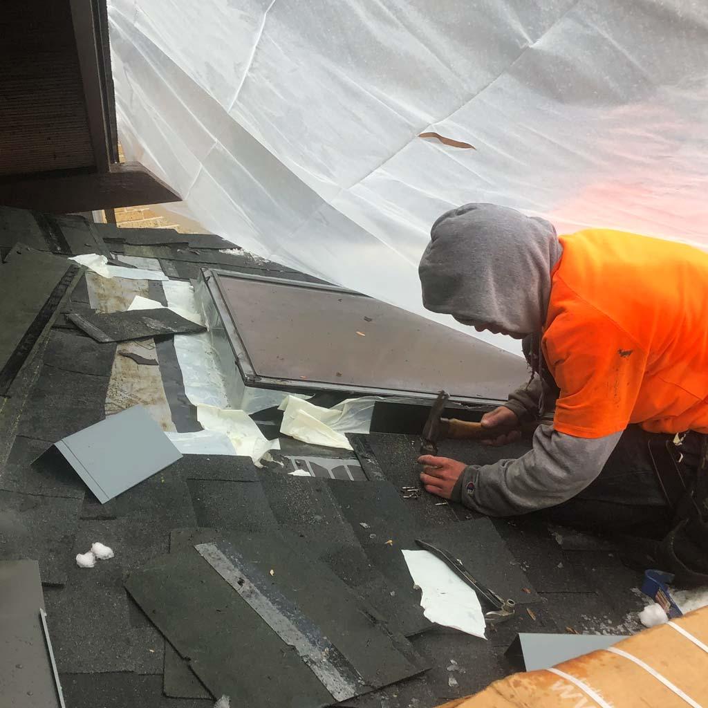 skylights on snowy roof 29515-7567