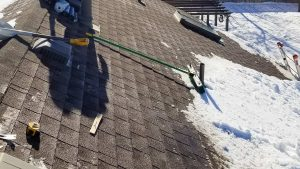 skylights on snowy roof 30105-113340
