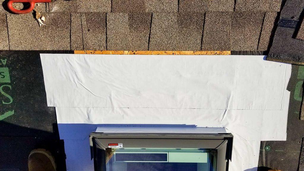 skylights on snowy roof 30105-124222
